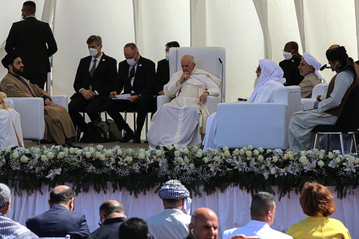 Pope Francis, center, listens during an interreligious meeting near the archaeological site of Ur near Nasiriyah, Iraq, Saturday, March 6, 2021. Pope Francis and Iraq's top Shiite cleric delivered a powerful message of peaceful coexistence Saturday, urging Muslims in the war-weary Arab nation to embrace Iraq's long-beleaguered Christian minority during an historic meeting in the holy city of Najaf. (AP Photo/Nabil al-Jourani)