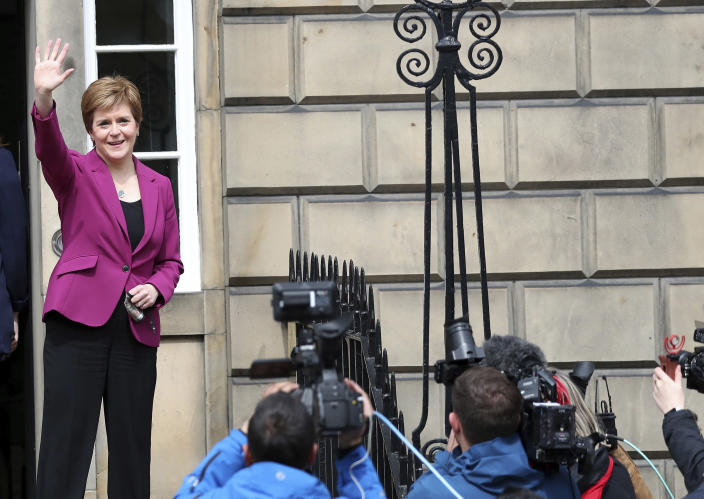 """Scotland's First Minister and Scottish National Party leader Nicola Sturgeon poses for photographers, at Bute House in Edinburgh, Scotland. Sunday, May 9, 2021. British Prime Minister Boris Johnson has invited the leaders of the U.K.'s devolved nations for crisis talks on the union after Scotland's pro-independence party won its fourth straight parliamentary election. Sturgeon said the election results proved a second independence vote for Scotland was """"the will of the country."""" She said any London politician who stood in the way would be """"picking a fight with the democratic wishes of the Scottish people."""" (AP Photo/Scott Heppell)"""