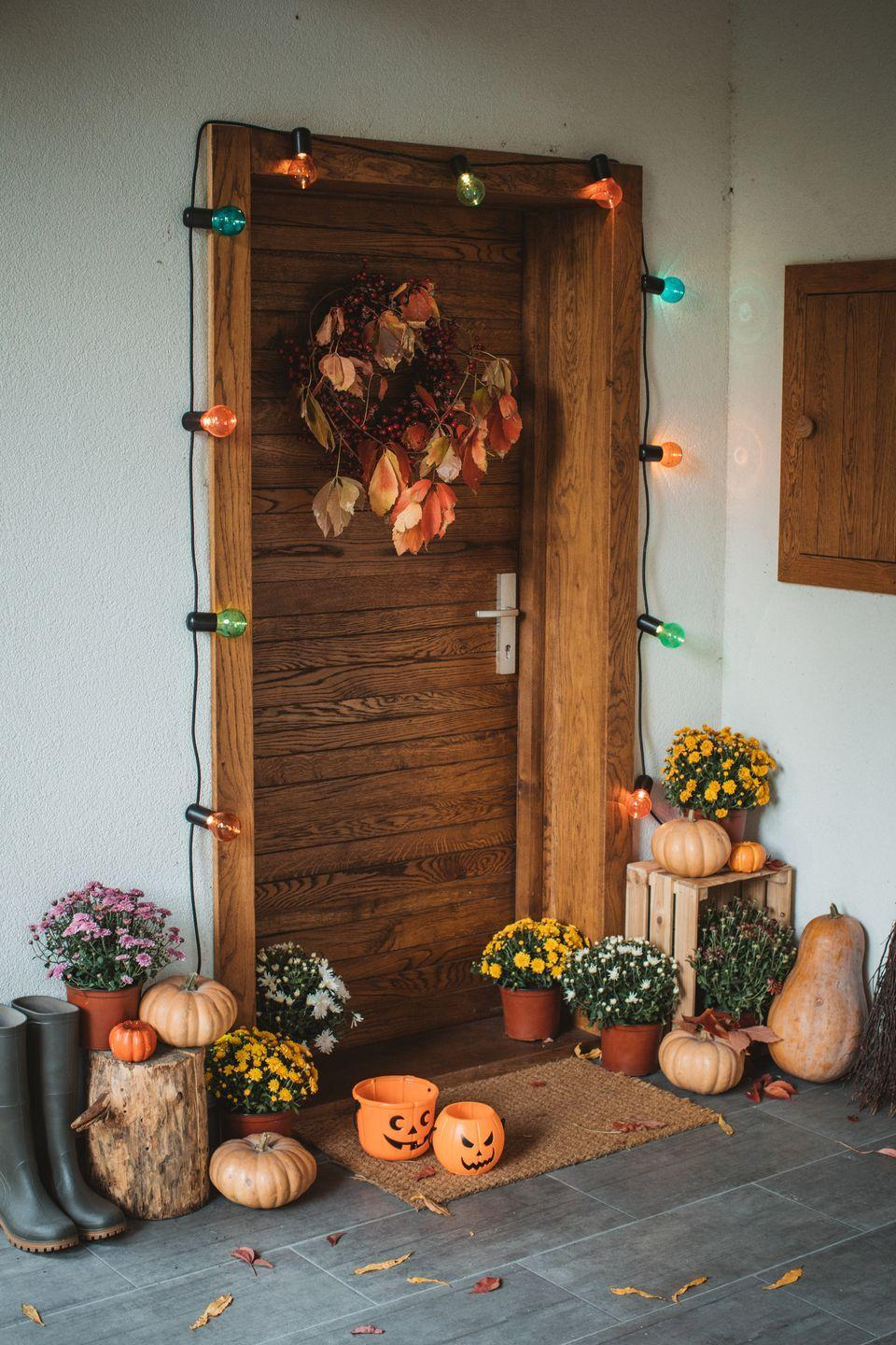"""<p>Let multicolored string lights set the foundation for your Halloween door decorations. Add even more visual appeal with a festive wreath, pumpkins, and flowers. <br><br><a class=""""link rapid-noclick-resp"""" href=""""https://go.redirectingat.com?id=74968X1596630&url=https%3A%2F%2Fwww.homedepot.com%2Fp%2FNovolink-25-Light-15-4-ft-Wi-Fi-RGB-Color-Changing-LED-C9-Christmas-String-Lights-works-with-Alexa-SLWA-C9-25%2F305168010&sref=https%3A%2F%2Fwww.goodhousekeeping.com%2Fholidays%2Fhalloween-ideas%2Fg32948621%2Fhalloween-door-decorations%2F"""" rel=""""nofollow noopener"""" target=""""_blank"""" data-ylk=""""slk:SHOP MULTICOLORED STRING LIGHTS"""">SHOP MULTICOLORED STRING LIGHTS</a></p>"""