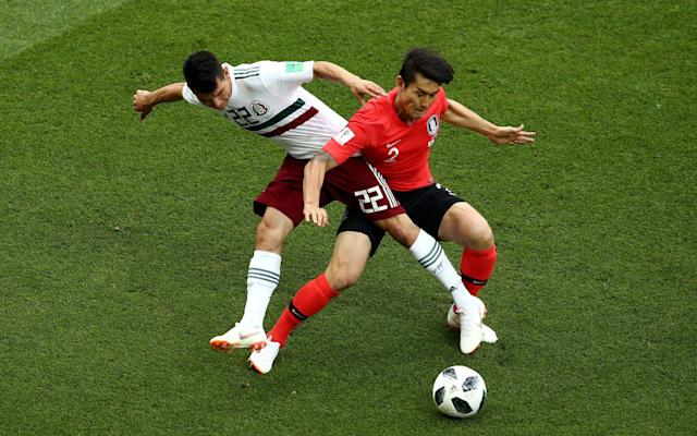 5:32PM 73 min South Korea 0-2 Mexico Ki shoots from 30m and into Marquez. Korea are trying to go for it. Here's Chichrito's goal: Javier Hernandez scores Mexico's second and his 50th goal for his country Credit: AP Photo/Efrem Lukatsky 5:29PM 71 min South Korea 0-2 Mexico Corona comes on for Lozano who leaves to a deserved standing ovation. 5:28PM 69 min South Korea 0-2 Mexico Lee Seung-woo replced Ju just before the goal. Marquez came on for Guardado just after. Chicharito, whose 50th goal for Mexico that was, takes the armband from his departing captain. 5:27PM 65 min South Korea 0-2 Mexico Lovely counter-attack even if he scuffed the shot. Herrera trips Ki to win the ball back but the referee deems it legal and signals play on. Lozano skates forward at top speed, losing defenders as he moves into sixth gear and approaches the box. He threads the perfect pass to Hernandez to the left of the area and he takes a touch to throw Cho off balance then shoots past him, the ball coming off the side of his foot, fairly high up with a youch of ankle too. Korea Rep 0 - 2 Mexico (Chicharito, 66 min) 5:24PM GOAL!! South Korea 0-2 Mexico Chicharito makes it 2-0 on the break. 5:23PM 63 min South Korea 0-1 Mexico Danger here! And there! Attempts at both ends - Lee Jae-sung's daisycutter is blocked by Salcedo inside the box then Mexico break sharply. Layun sets up Vela to shoot and he swerves it wide of the right post. Miss: Korea Rep 0 - 1 Mexico (Carlos Vela, 62 min) 5:20PM 61 min South Korea 0-1 Mexico Terrific infield run from Lozano, cutting off the right flank to trap Moreno's long ball over the top. He had crept behind the back four, stayed onside with formidable timing, stunned it and took it towards the keeper. His first effort is blocked and he can't execute the lob to score. 5:17PM 59 min South Korea 0-1 Mexico Kim Young-gwon is booked for his sixth or seventh niggly foul and Mexico move the ball quickly forward from the free-kick, up to Guardado and the captain exploit