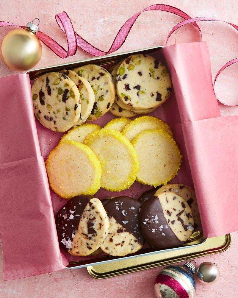 """<p>Choose from three flavors—fruit and nut, lemon, or chocolate (we recommend making them all!)—and package up the perfect cookie box for all your friends and neighbors.</p><p><strong><a href=""""https://www.countryliving.com/food-drinks/a34330858/slice-and-bake-shortbread-cookies/"""" rel=""""nofollow noopener"""" target=""""_blank"""" data-ylk=""""slk:Get the recipe"""" class=""""link rapid-noclick-resp"""">Get the recipe</a>.</strong></p><p><a class=""""link rapid-noclick-resp"""" href=""""https://www.amazon.com/Walkingpround-Storage-Containers-Silver-Rectangular/dp/B07C15JV9H/ref=sr_1_8?tag=syn-yahoo-20&ascsubtag=%5Bartid%7C10050.g.645%5Bsrc%7Cyahoo-us"""" rel=""""nofollow noopener"""" target=""""_blank"""" data-ylk=""""slk:SHOP COOKIE TINS"""">SHOP COOKIE TINS</a></p>"""
