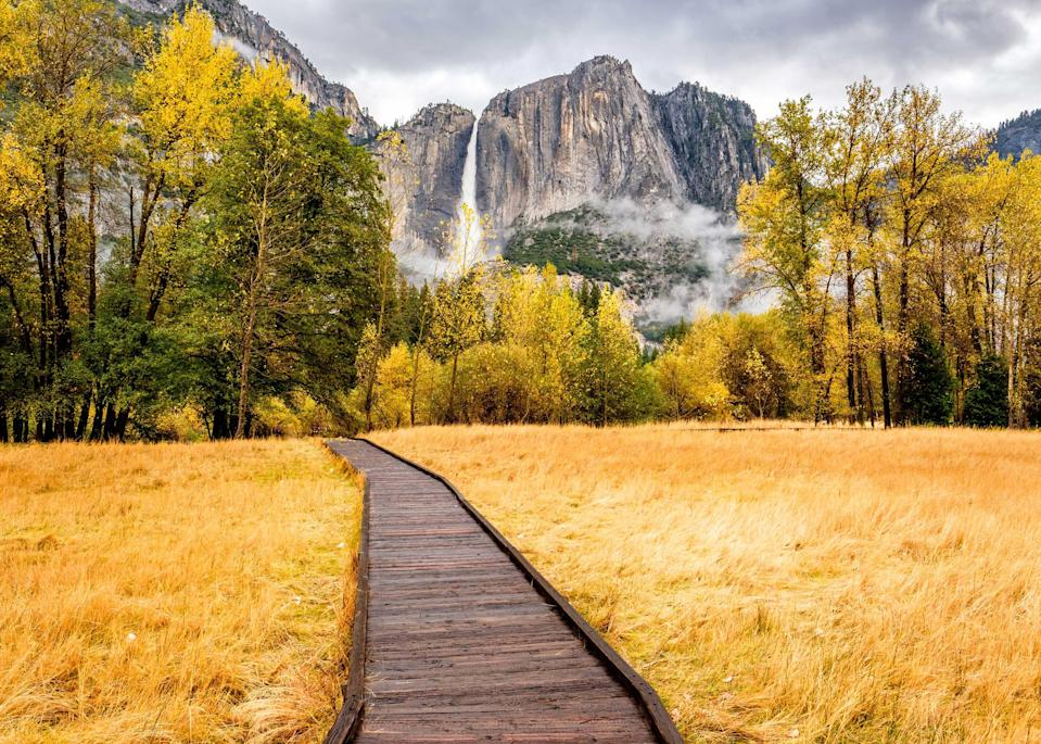"""There's a spectacular reason why this park is one of the best places to visit in February, especially in the last two weeks of the month: <a href=""""https://www.cntraveler.com/story/yosemite-firefall-is-back?mbid=synd_yahoo_rss"""" rel=""""nofollow noopener"""" target=""""_blank"""" data-ylk=""""slk:the Yosemite Firefall"""" class=""""link rapid-noclick-resp"""">the Yosemite Firefall</a>. Each day, just before and after sunset, winter sunlight strikes a waterfall tumbling down the eastern granite of El Capitan at an angle that causes the light to refract, making the water glow reddish orange, like a lava flow. If that isn't enough, look out for frazil ice each morning, which turns creeks into real-life slushies after mist freezes and then floats downstream. The most likely place for this to occur is at Yosemite Creek, just below Lower Yosemite Falls. The 320-foot drop falls are themselves a major attraction, and a great winter hike for families; a stroll through the Tuolumne Grove of Giant Sequoias is always majestic no matter the season. While temporarily closed due to the pandemic, the 1920s-era Ahwahnee resort in the park's main valley is worth bookmarking for a future stay—the hotel's huge stone fireplaces are a cozy attraction. Check California's current pandemic protocols before making any plans; more detailed park-related information is regularly updated <a href=""""https://www.travelyosemite.com/"""" rel=""""nofollow noopener"""" target=""""_blank"""" data-ylk=""""slk:here"""" class=""""link rapid-noclick-resp"""">here</a>."""