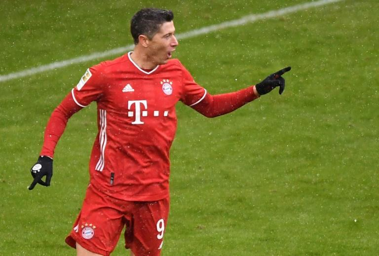 Bayern Munich striker Robert Lewandowski celebrates scoring a league-record 21 goals for the first half of the season