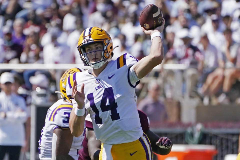 LSU quarterback Max Johnson (14) passes against Mississippi State during the first half of an NCAA college football game, Saturday, Sept. 25, 2021, in Starkville, Miss. (AP Photo/Rogelio V. Solis)