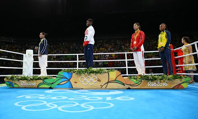 2016 Rio Olympics - Boxing - Victory Ceremony - Women's Fly (51kg) Victory Ceremony - Riocentro - Pavilion 6 - Rio de Janeiro, Brazil - 20/08/2016. (From L) Silver medallist Sarah Ourahmoune (FRA) of France, gold medallist Nicola Adams (GBR) of Britain and bronze medallists Ren Cancan (CHN) of China and Ingrid Valencia (COL) of Colombia listen to the playing of the anthem. REUTERS/Peter Cziborra FOR EDITORIAL USE ONLY. NOT FOR SALE FOR MARKETING OR ADVERTISING CAMPAIGNS.