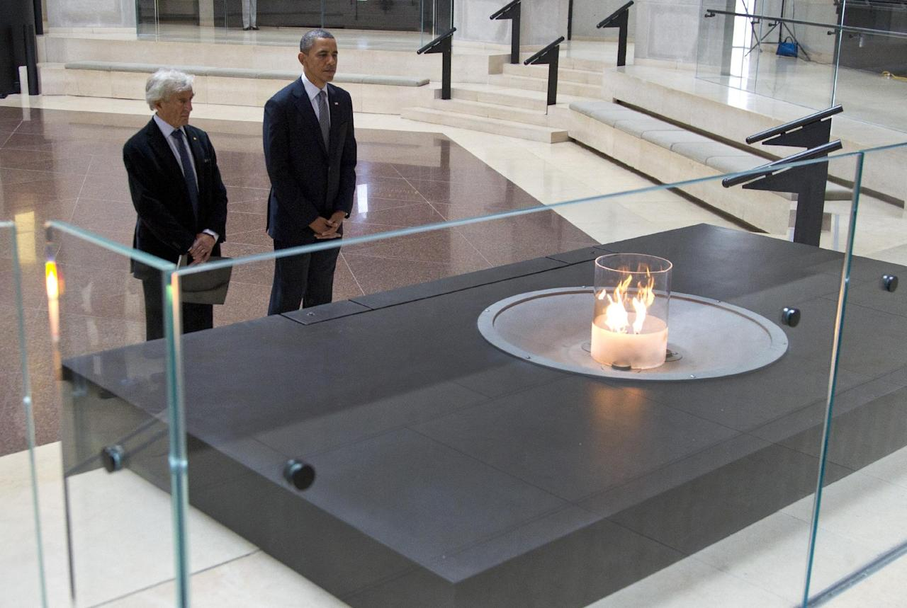 President Barack Obama and Nobel Peace Prize laureate and Holocaust survivor Elie Wiesel stop for a moment of silence in the Hall of Remembrance as they toured the Holocaust Memorial Museum in Washington, Monday, April 23, 2012. (AP Photo/Carolyn Kaster)