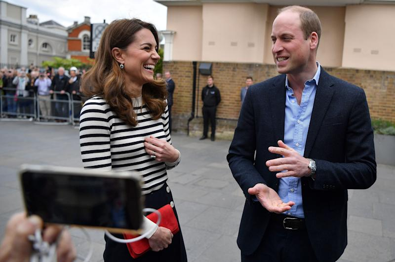 Britain's Catherine, Duchess of Cambridge (L) and Britain's Prince William, Duke of Cambridge talk to members of the media about their newborn nephew, as they arrive to launch the King's Cup Regatta, at the Cutty Sark in Greenwich, south east London on May 7, 2019. - The event is set to take place on August 9, 2019, on the Isle of Wight, and is set to see The Duke and Duchess go head to head as skippers of individual sailing boats, in an eight boat regatta race. Each boat taking part will represent one of eight charities and the winning team will be awarded the historic trophy The King's Cup. (Photo by Ben STANSALL / POOL / AFP) (Photo credit should read BEN STANSALL/AFP/Getty Images)
