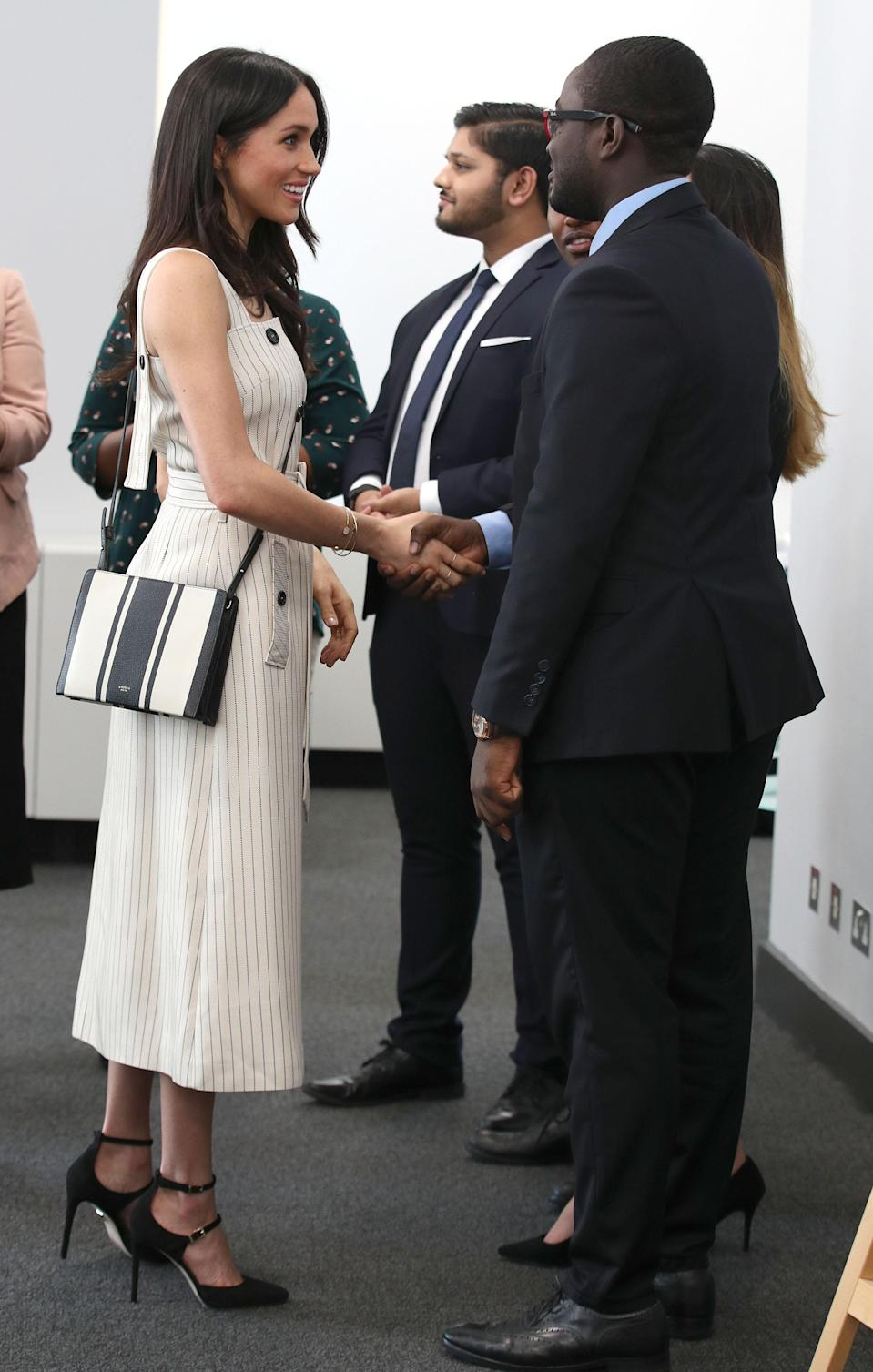 "<p>Not all of Meghan's subsersive fashion moments are met with admiration.<br>Arriving at the Commonwealth Youth Forum in April 2018 wearing an strappy Altuzarra pinstripe midi dress, the now-Duchess got a quick lesson in the furore of hard-core royalists.<br>The seemingly inoffensive strappy dress – which bared her bare shoulders – was <a rel=""nofollow"" href=""https://uk.style.yahoo.com/meghan-markle-faces-huge-backlash-wearing-strapless-dress-dressing-like-celeb-084650788.html?guccounter=1"" data-ylk=""slk:met with abuse online;outcm:mb_qualified_link;_E:mb_qualified_link;ct:story;"" class=""link rapid-noclick-resp yahoo-link"">met with abuse online</a>. <br></p><p>Still, she looked incredible. <br>[Photo: Getty] </p>"