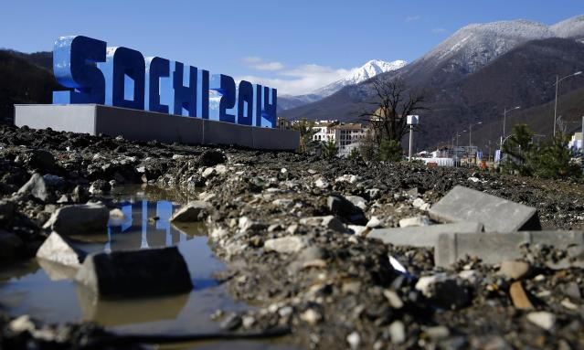 Mud is pictured in front of a Sochi sign near the village of Esto Sadok at the Rosa Khutor alpine resort near Sochi, February 2, 2014. Sochi will host the 2014 Winter Olympic Games from February 7 to 23. REUTERS/Kai Pfaffenbach (RUSSIA - Tags: SPORT OLYMPICS)