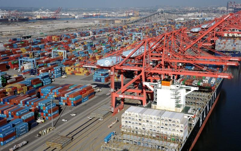 Cranes and containers are seen at the Ports of Los Angeles and Long Beach, California in this aerial image