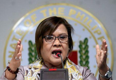 Philippine Senator Leila de Lima gestures during a news conference at the Senate headquarters in Pasay city