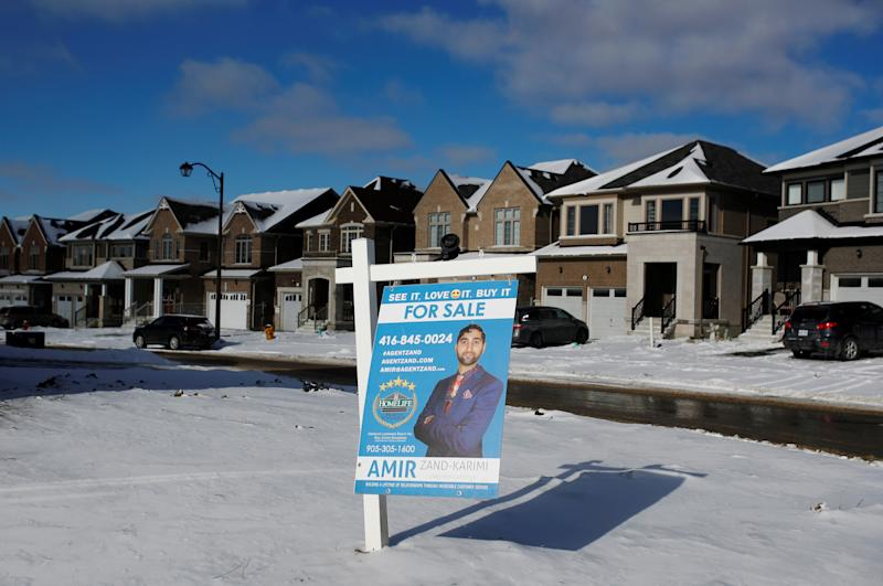 A real estate for sale sign is seen in a newly built subdivision in East Gwillimbury, Ontario, Canada, January 30, 2018. Picture taken January 30, 2018. REUTERS/Mark Blinch