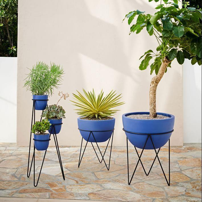 """<p><strong>West Elm</strong></p><p>westelm.com</p><p><a href=""""https://go.redirectingat.com?id=74968X1596630&url=https%3A%2F%2Fwww.westelm.com%2Fproducts%2Firis-planter-chevron-stand-petrol-blue-d6330&sref=https%3A%2F%2Fwww.housebeautiful.com%2Fshopping%2Fg33337693%2Fwest-elm-is-having-a-huge-summer-saleheres-what-to-buy%2F"""" rel=""""nofollow noopener"""" target=""""_blank"""" data-ylk=""""slk:Shop Now"""" class=""""link rapid-noclick-resp"""">Shop Now</a></p><p><del>$129</del><strong><br>$89.99</strong></p><p>If you want to flex your green thumb this summer, pick up a few outdoor planters. These pretty cobalt ones look just as good as the leafy greens you'll place inside. </p>"""