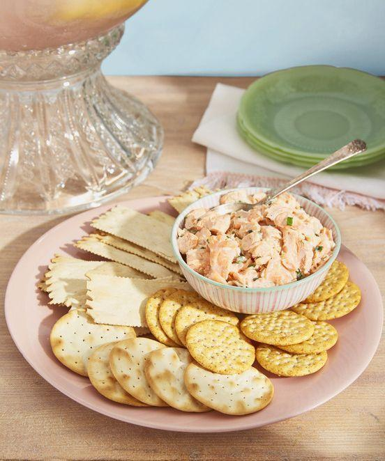 """<p>This creamy rich spread is never out of place at a party. </p><p><strong><a href=""""https://www.countryliving.com/food-drinks/a35916468/salmon-rillettes-recipe/"""" rel=""""nofollow noopener"""" target=""""_blank"""" data-ylk=""""slk:Get the recipe"""" class=""""link rapid-noclick-resp"""">Get the recipe</a>.</strong></p>"""