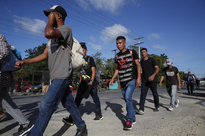 A group of migrants walk on their way to the United States, near El Cinchado, Guatemala, Wednesday, Jan. 15, 2020, on the border with Honduras. Hundreds of mainly Honduran migrants started walking and hitching rides from the city of San Pedro Sula and crossed the Guatemala border in a bid to form the kind of migrant caravan that reached the U.S. border in 2018. (AP Photo/Moises Castillo)