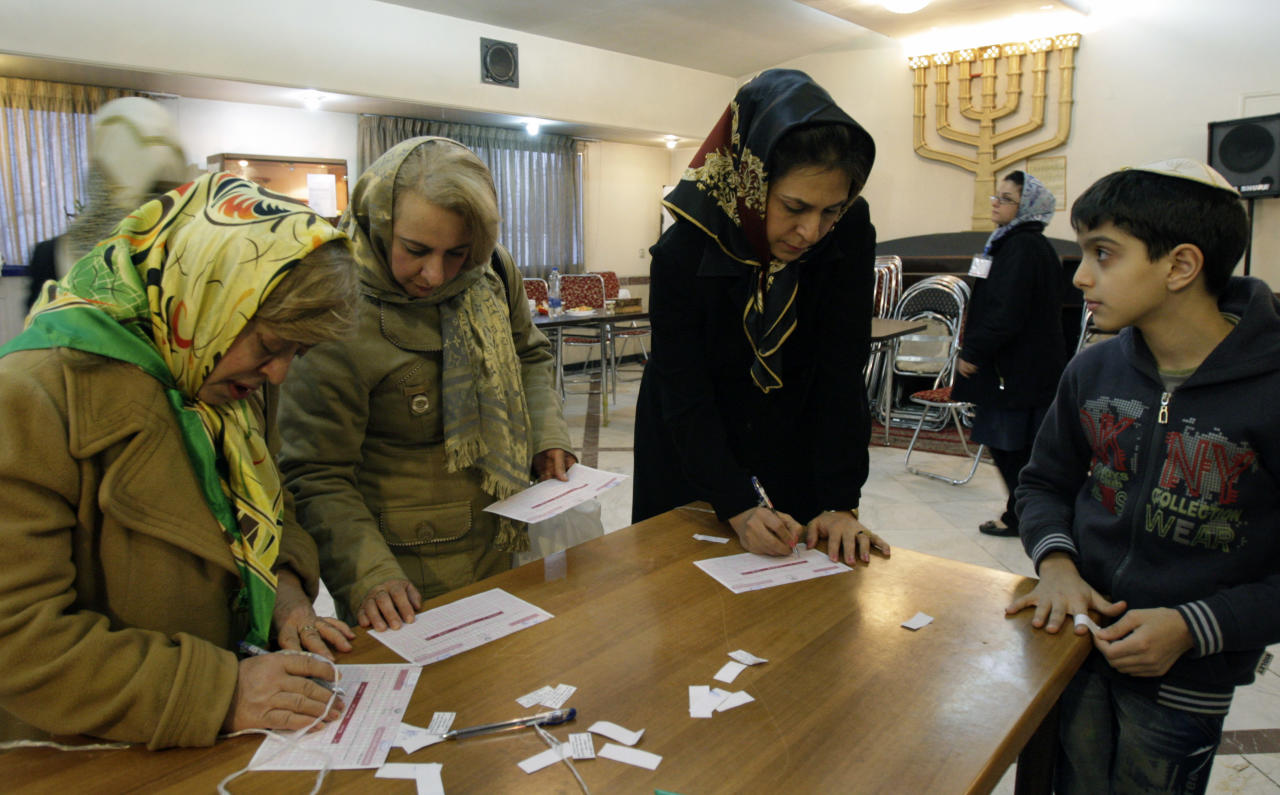 Iranian Jewish women fill in their ballots during the parliamentary elections, in their polling station in Tehran, Iran, Friday, March 2, 2012. The balloting for the 290-member parliament is the first major voting since the disputed re-election of President Mahmoud Ahmadinejad in June 2009 and the mass protests and crackdowns that followed. Under the Iranian constitution Jewish community has one representative in the parliament. (AP Photo/Vahid Salemi)