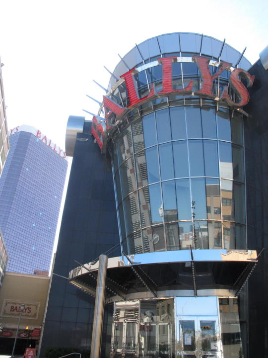 This Oct. 1, 2020, photo shows the exterior of Bally's casino in Atlantic City, N.J. The online sports betting company FanDuel will open an in-person sports book at Bally's casino in Atlantic City once the casino's sale to a Rhode Island company is finalized. FanDuel told The Associated Press on Wednesday, Oct. 28, 2020, that it has plans for a temporary sports betting facility in the casino before the end of the year, and will build a permanent sports book on the center of the casino floor next spring. (AP Photo/Wayne Parry)