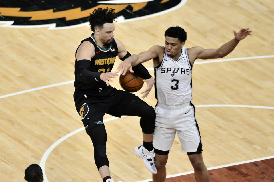 Memphis Grizzlies forward Dillon Brooks (24) and San Antonio Spurs forward Keldon Johnson (3) struggle for control of the ball during the second half of an NBA basketball Western Conference play-in game Wednesday, May 19, 2021, in Memphis, Tenn. (AP Photo/Brandon Dill)