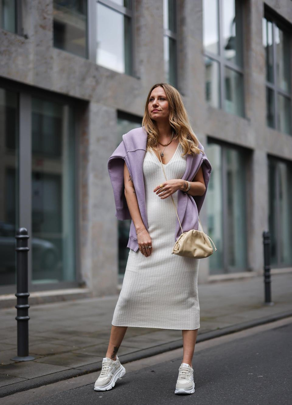 <p>For an off-duty uniform, style your knit dress with a pair of sneakers and wrap a sweater around your neck to keep the chills away. Dial up the practicality with a crossbody bag, and you've just found your everyday look.</p>