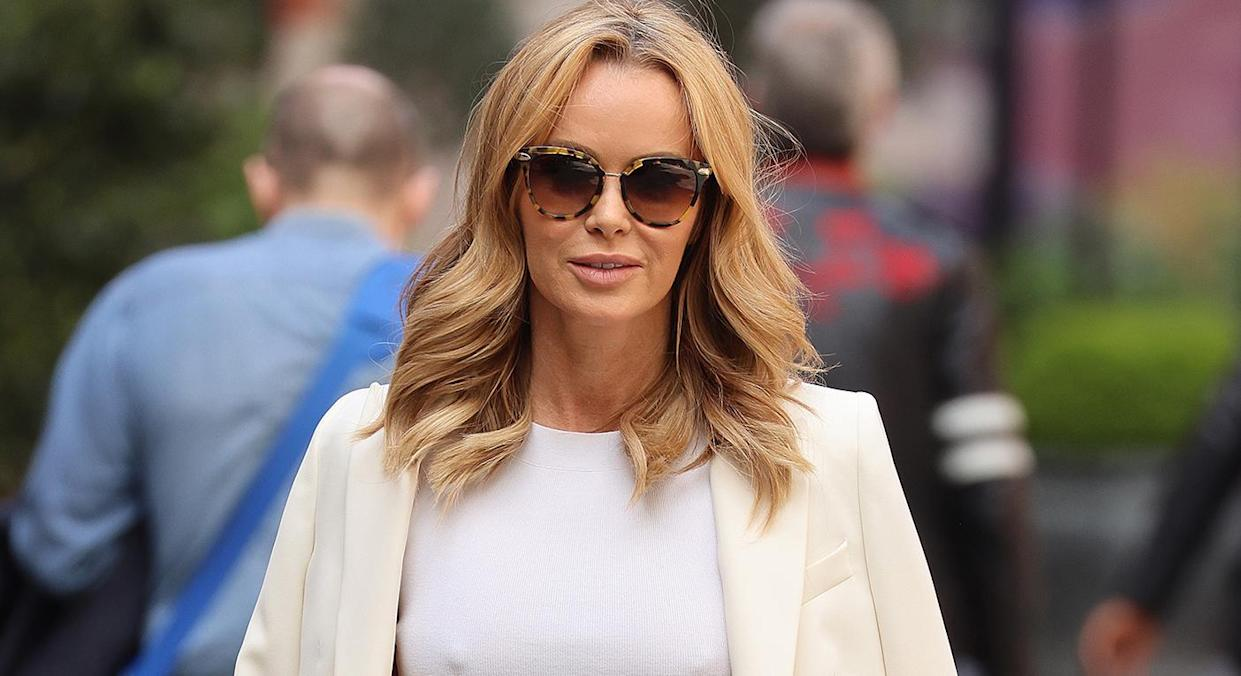 Amanda Holden enjoys the sunshine in white bikini and white shirt - here's how to get the look. (Getty Images)