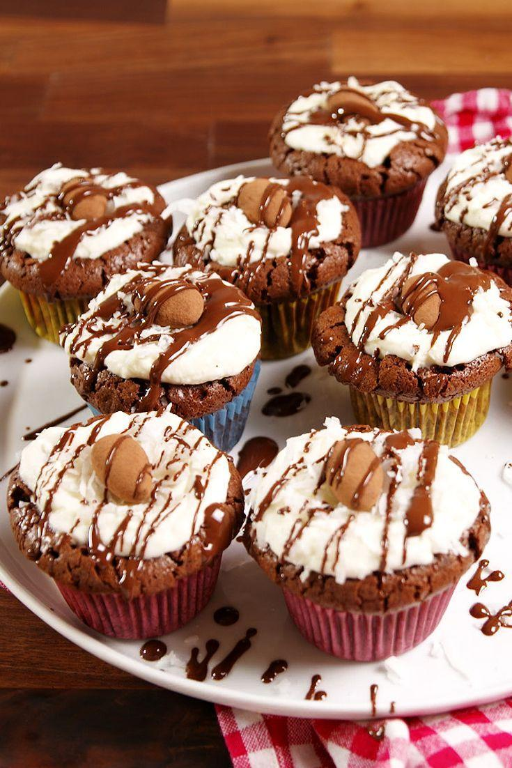 """<p>These candy-inspired cupcakes are a hit with coconut fans.</p><p>Get the recipe from <a href=""""https://www.delish.com/cooking/recipe-ideas/recipes/a51438/almond-joy-cupcakes-recipe/"""" rel=""""nofollow noopener"""" target=""""_blank"""" data-ylk=""""slk:Delish"""" class=""""link rapid-noclick-resp"""">Delish</a>. </p>"""