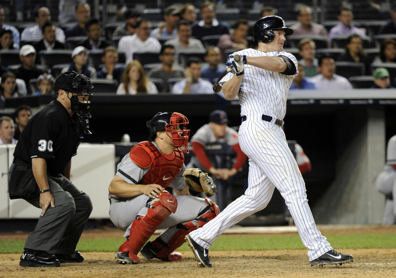 New York Yankees' Lyle Overbay, right, hits a two-RBI single as Boston Red Sox catcher Ryan Lavarnway, center, and umpire Rob Drake look on during the seventh inning of a baseball game onThursday, Sept. 5, 2013, at Yankee Stadium in New York. (AP Photo/Bill Kostroun)