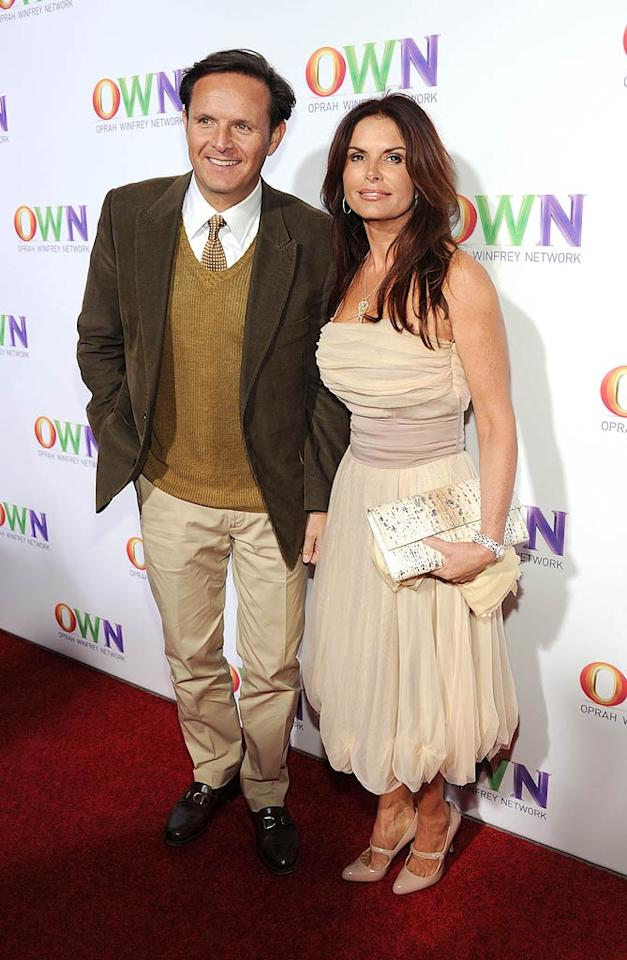 """""""Survivor"""" creator Mark Burnett and his wife, former """"Touched by an Angel"""" star Roma Downey, were all smiles at the soiree. Burnett serves as executive producer of """"Your OWN Show,"""" a reality series where 10 people are competing to become the host of their own show on the Oprah Winfrey Network. Frazer Harrison/<a href=""""http://www.gettyimages.com/"""" target=""""new"""">GettyImages.com</a> - January 6, 2011"""