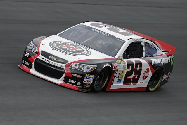Kevin Harvick drives his car out of Turn 4 during practice for Saturday's NASCAR Sprint Cup series auto race at Charlotte Motor Speedway in Concord, N.C., Thursday, Oct. 10, 2013. (AP Photo/Chuck Burton)