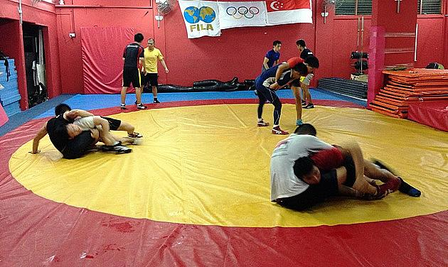 Back to the grind for Singapore's national wrestlers, who train for two hours in the evening every day. (Yahoo! Photo)