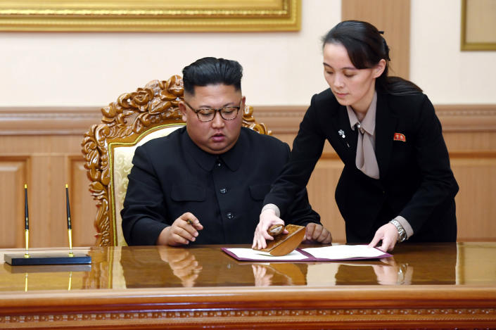 """FILE - In this Sept. 19, 2018, file photo, Kim Yo Jong, right, sister of North Korean leader Kim Jong Un, helps Kim sign joint statement following the summit with South Korean President Moon Jae-in at the Paekhwawon State Guesthouse in Pyongyang, North Korea. Kim's prolonged public absence has led to rumors of ill health and worries about how it could influence the future of what one analyst calls Northeast Asia's """"Achilles' heel,"""" a reference to the North's belligerence and unpredictable nature. (Pyongyang Press Corps Pool via AP, File)"""