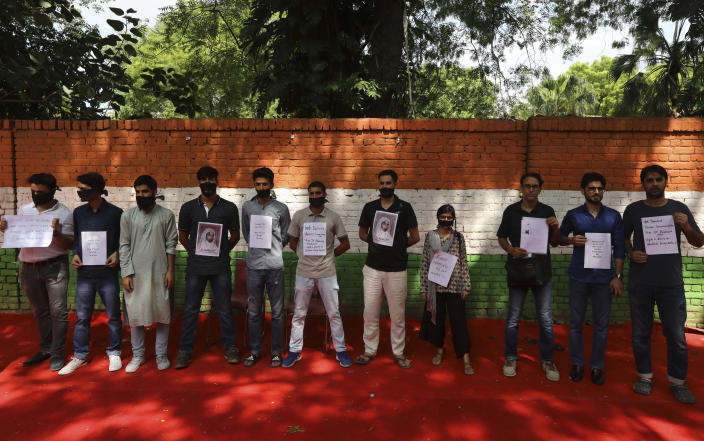 Kashmiris residing in Delhi and supporters take out a silent protest against the Indian government revoking Kashmir's special constitutional status in New Delhi, India, Friday, Aug. 9, 2019. The mostly-Muslim region has been under an unprecedented security lockdown and near-total communications blackout to prevent unrest as India's Hindu nationalist-led government announced it was revoking Kashmir's special constitutional status and downgrading its statehood. (AP Photo/Manish Swarup)