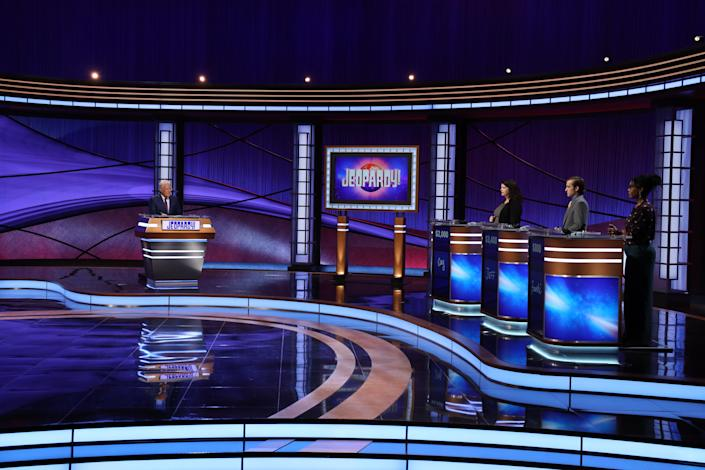 """""""Jeopardy!"""" has returned from its COVID-19 hiatus with an upgraded stage, with socially distanced contestants (right) who remain a safe distance away from host Alex Trebek."""