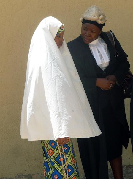 Wasila Tasiu speaks with a lawyer during a trial hearing at Kano state High Court in Gezawa outside Kano on October 30, 2014 (AFP Photo/Aminu Abubakar)