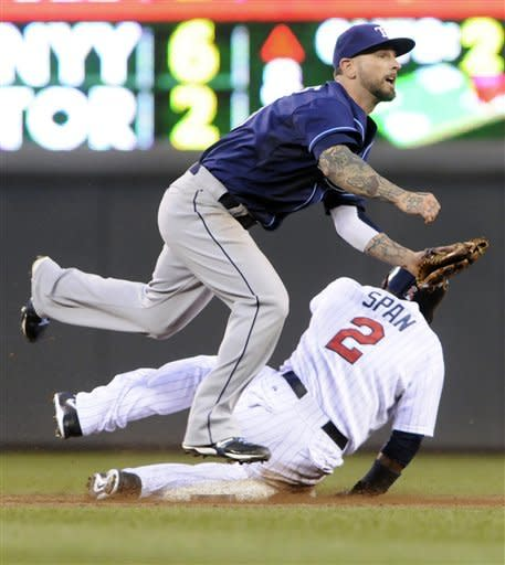 Tam Bay Rays second baseman Ryan Roberts, top, completes the double play hit into by Minnesota Twins' Ben Revere after the force-out at second of Denard Span, bottom, in the third inning of a baseball game on Friday, Aug. 10, 2012, in Minneapolis. (AP Photo/Jim Mone)
