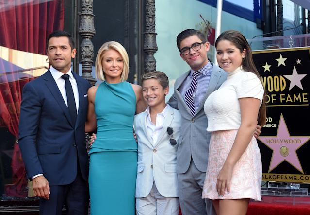 From left, Mark Consuelos and Kelly Ripa, and their children Joaquin, Michael, and Lola. (Photo: Getty Images)