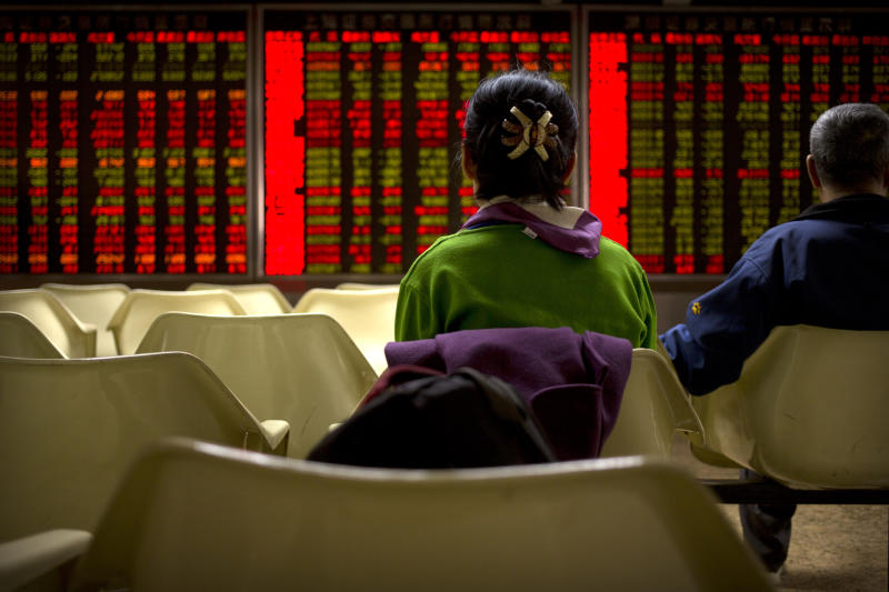 Asian markets mixed as investors look ahead to Fed report