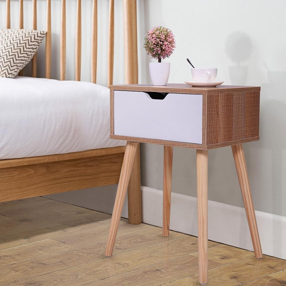 """<p>We love the look of this <a href=""""https://www.popsugar.com/buy/Jaxpety-Mid-Century-Wooden-Nightstand-Side-End-Table-489940?p_name=Jaxpety%20Mid-Century%20Wooden%20Nightstand%20Side%20End%20Table&retailer=walmart.com&pid=489940&price=39&evar1=casa%3Auk&evar9=46607561&evar98=https%3A%2F%2Fwww.popsugar.com%2Fhome%2Fphoto-gallery%2F46607561%2Fimage%2F46608065%2FJaxpety-Mid-Century-Wooden-Nightstand-Side-End-Table&list1=shopping%2Cwalmart%2Corganization%2Cbedrooms%2Chome%20organization%2Chome%20shopping&prop13=api&pdata=1"""" rel=""""nofollow"""" data-shoppable-link=""""1"""" target=""""_blank"""" class=""""ga-track"""" data-ga-category=""""Related"""" data-ga-label=""""https://www.walmart.com/ip/Jaxpety-Mid-Century-Wooden-Nightstand-Side-End-Table-with-White-Storage-Drawer-for-Bedroom-Living-Room/587031066"""" data-ga-action=""""In-Line Links"""">Jaxpety Mid-Century Wooden Nightstand Side End Table</a> ($39).</p>"""