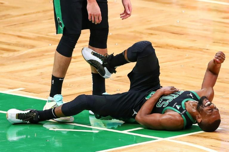 Boston's Kemba Walker, making his NBA season debut after missing 11 games with a knee injury, suffers an apparent rib injury in the third quarter of the Celtics' loss to the New York Knicks