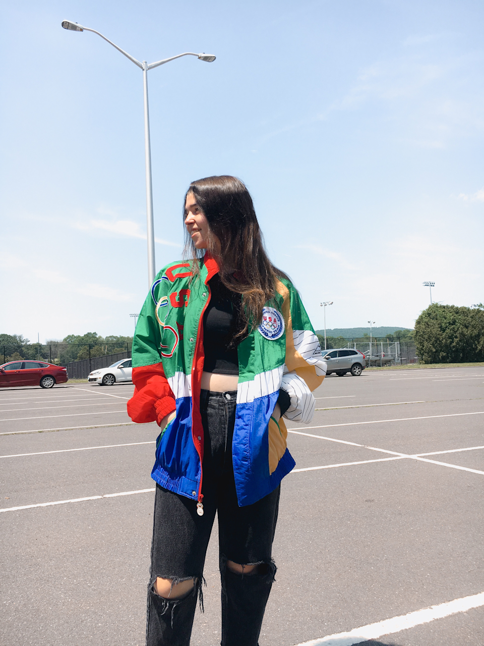 Melissa Fraistat, 22, shows off the jacket, vintage jeans and crop top she thrifted.