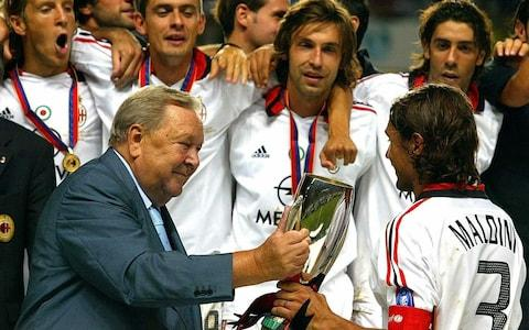 Paolo Maldini (R) of AC Milan receives the cup from UEFA President Lennart Johansson after AC Milan won the UEFA Super Cup match against FC Porto - Credit: EPA