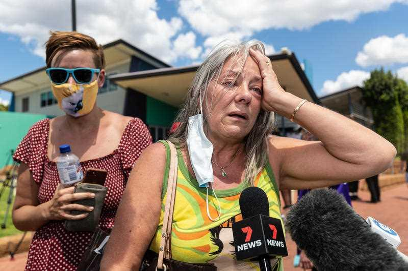 Pamela Wheeler-Hart reacts whilst telling the media after a community meeting that her house has been destroyed in Gidgegannup, Perth.