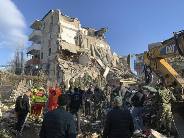 Rescuers search at a damaged building in Thumane. (Photo: Visar Kryeziu/AP)