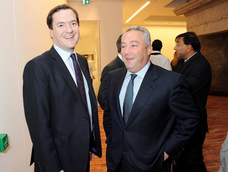 LONDON, ENGLAND - SEPTEMBER 24: Chancellor George Osborne (L) and Michael Sherwood attend a donors dinner hosted by Michael Bloomberg & Graydon Carter to celebrate the launch of the new Serpentine Sackler Gallery designed by Zaha Hadid on September 24, 2013 in London, England. (Photo by David M. Benett/Getty Images)