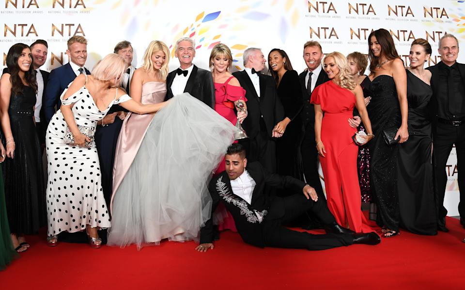 """LONDON, ENGLAND - JANUARY 28: Holly Willoughby, Phillip Schofield, Dr Ranj Singh, Ruth Langsford, Eamonn Holmes, Rochelle Humes, Lisa Snowdon and the cast of """"This Morning"""", pose in the winners room after winning the Live Magazine Show award  during the National Television Awards 2020 at The O2 Arena on January 28, 2020 in London, England. (Photo by Gareth Cattermole/Getty Images)"""
