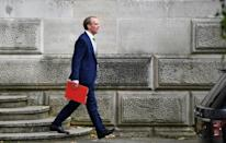 """Britain's Foreign Secretary Dominic Raab on his way to parliament where he told MPs """"we will live up to our promises"""" regarding Hong Kong"""