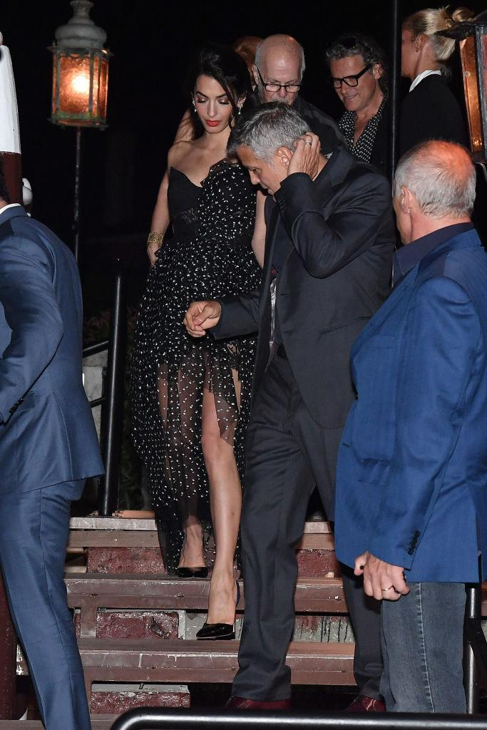 <p><strong>When: August 31, 2017</strong><br>Amal's dress was from Ermanno Scervino's Fall 2017 Ready-to-Wear Collection. <em>(Photo: Getty)</em> </p>