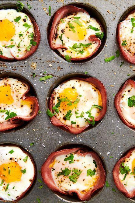 """<p>This low-carb breakfast comes together in no time—seriously, you only need 20-ish minutes! If you like your eggs super-runny, you might want to pull them from the oven a minute before you think they're ready.</p><p>Get the <a href=""""https://www.delish.com/uk/cooking/recipes/a29030029/ham-cheese-egg-cups-recipe/"""" rel=""""nofollow noopener"""" target=""""_blank"""" data-ylk=""""slk:Ham & Egg Cups"""" class=""""link rapid-noclick-resp"""">Ham & Egg Cups</a> recipe.</p>"""