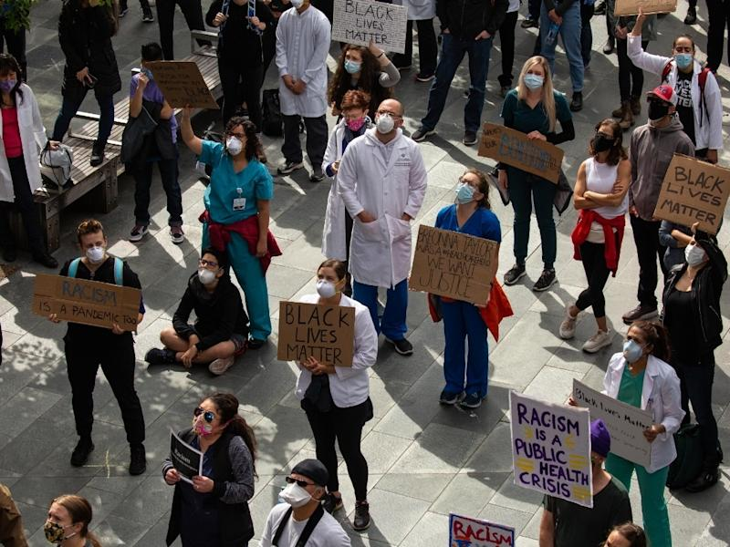 Healthcare workers and others rally at Seattle City Hall after marching from Harborview Medical Center during the Doctors For Justice event on June 6, 2020 in Seattle,Washington.
