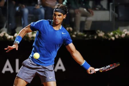Rafael Nadal of Spain hits a return to Andy Murray of Britain during their men's singles quarter-final match at the Rome Masters tennis tournament