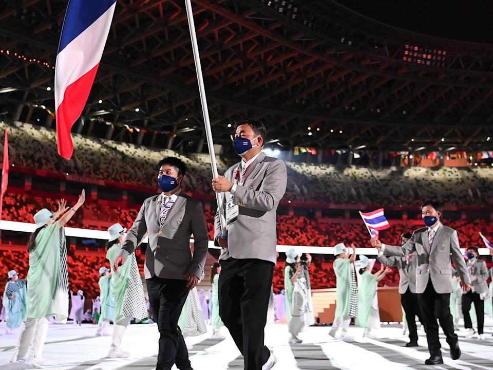 thailand olympic team entering opening ceremony at tokyo games
